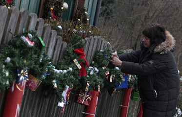 Haubrich attaches the final decorations on her garden fence, before starting the annual house illumination in Freising