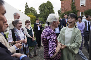 Myanmar pro-democracy leader Aung San Suu Kyi speaks with old friends during a reception at Oxford University