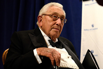 Former U.S. Secretary of State Henry Kissinger poses for photographs ahead of the Appeal of Conscience Foundation award ceremony dinner in New York