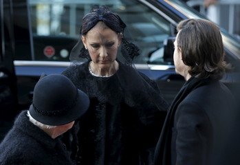 Celine Dion arrives with her son Rene-Charles and mother Therese for the funeral of her husband Rene Angelil at Notre Dame Basilica in Montreal