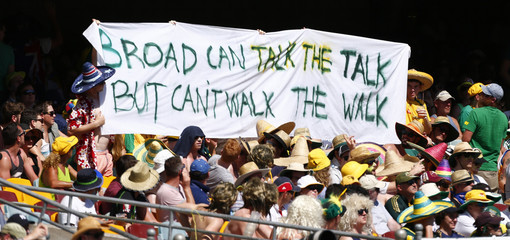 Members from the crowd hold up a banner during the first Ashes test cricket match between England and Australia in Brisbane