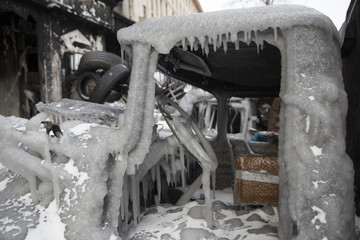 Cabin of a gutted truck is seen covered with ice at fortifications by anti-government protesters in Kiev