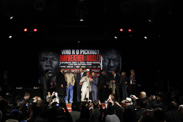 Welterweight boxer Mayweather and current WBA welterweight world champion Mosley pose during a news conference in New York