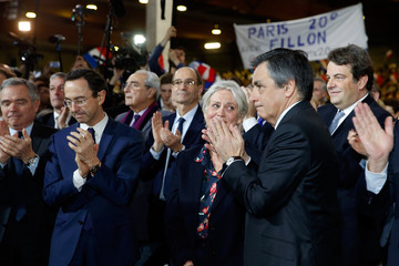 Francois Fillon former French prime minister, member of The Republicans political party and 2017 presidential candidate of the French centre-right, applauds as he stands by his wife Penelope Fillon as they attend a political rally in Paris
