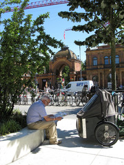 A tourist reads a city map in front of the Tivoli Gardens in Copenhagen