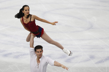 Falicia Zhang and Nathan Bartholomay of the U.S compete during the pairs free skating program at the ISU World Figure Skating Championships in Saitama, Japan