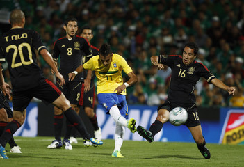 Brazil's Neymar is challenged by Mexico's Castro during their international friendly soccer match in Torreon