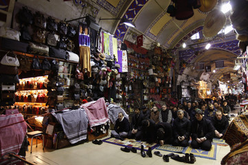 Merchants attend Friday prayers at Grand Bazaar, which was built during the Ottoman-era, in Istanbul