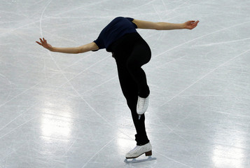 South Korea's Kim Yuna practises her routine during a figure skating training session during the 2014 Sochi Winter Olympics