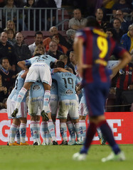 Celta de Vigo's players celebrate a goal against Barcelona during their Spanish first division soccer match in Barcelona