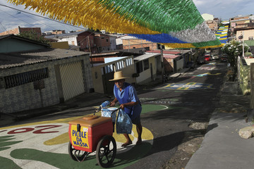 An ice cream vendor pushes his cart along Third Street of the Alvorada neighbourhood, which is decorated for the 2014 World Cup in Manaus