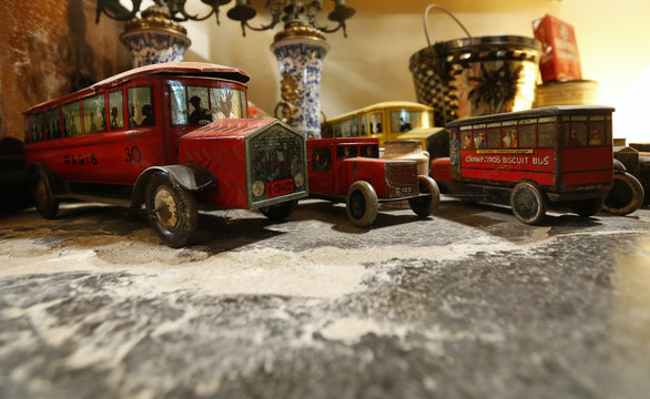 Vintage lithographed tin boxes designed in the shape of vehicles, which are part of a huge collection, are displayed at the house of Dardenne in Grand-Hallet