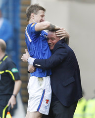 Rangers' team manager Ally McCoist celebrates with player Dorin Goian after their second goal during their Scottish Premier League 'Old Firm' soccer match against Celtic in Glasgow