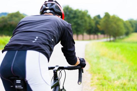 Man on race bike doing sport cycling