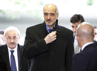 Syrian Ambassador to the U.N. Bashar al Jaafari(C) arrives at the United Nation in Geneva