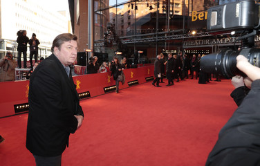 Director Aki Kaurismaki arrives for the screening of the movie 'The Other Side of Hope' at the 67th Berlinale International Film Festival in Berlin