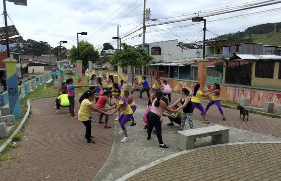 Women take part in an aerobics class in Los Guidos de Desamparados