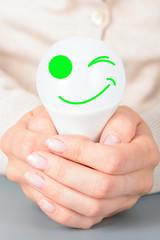 Female hands holding a led light bulb