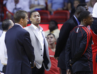 Injured Bulls' Rose stands during a time out during the second quarter in Game 5 of their NBA Eastern Conference semi-final basketball playoff against the Heat in Miami