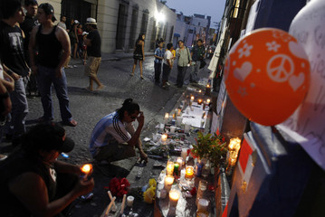 People take part in a candlelight vigil in downtown Monterrey