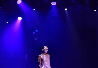 A model presents a creation by Charini during the final day of Colombo Fashion Week