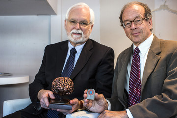 Professors Donoghue and Nurmikko, pose for a picture after receiving an award for their work in the field of brain technology at a conference in Tel Aviv