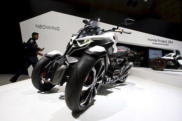Man walks past a Honda Neowing tricycle at the 44th Tokyo Motor Show in Tokyo
