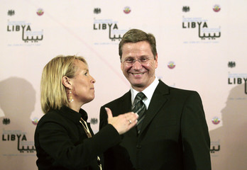 Danmark's Foreign Minister Espersen talks with her German counterpart Westerwelle  before the start of the first international contact group meeting on Libya in Doha