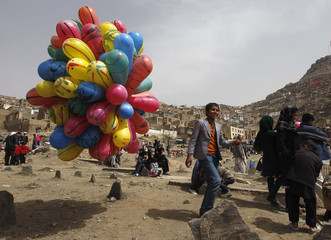 An Afghan boy sells balloons during a gathering to celebrate the Afghan New Year (Nawroz) in Kabul