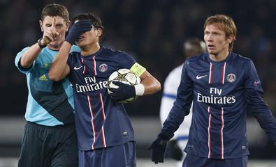Paris St Germain's Silva reacts as referee Thomson gestures during their Champions League soccer match against FC Porto at Parc des Princes stadium in Paris