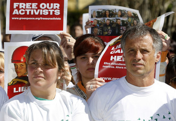 Camila Speziale's parents Paula and Nestor join Greenpeace activists during a demonstration against the detention of Greenpeace activists in Russia, in Buenos Aires