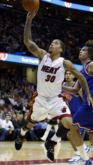 Miami Heats Beasley puts up a shot after being fouled by Cleveland Cavaliers Varejao in Cleveland