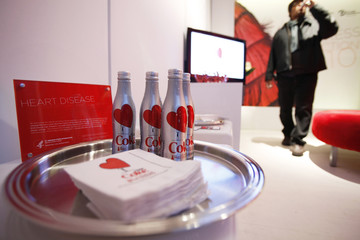 Specially made bottles of Diet Coke sit on a platter with the logo for the the Heart Truth's Red Dress Fall 2010 show during New York Fashion Week
