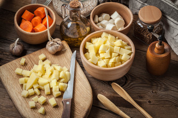 Diced potatoes on a wooden chopping board.
