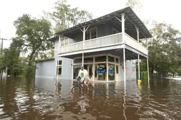 Dan Brennan looks at the flooding in the Olde Towne area after Hurricane Isaac passed through Slidell