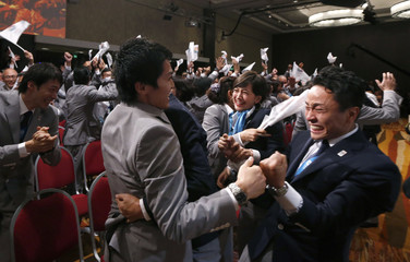 Members of the Tokyo bid committee celebrate as Jacques Rogge President of the International Olympic Committee announces Tokyo as the city to host the 2020 Summer Olympic Game during a ceremony in Buenos Aires