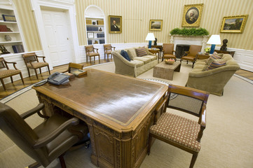 The Oval Office of Obama, seen from behind his desk, has new carpeting, wallpaper and sofas at the White House in Washington