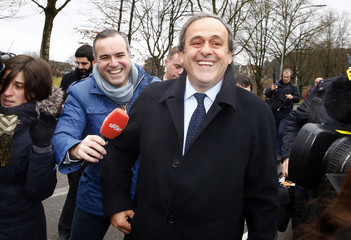 UEFA President Michel Platini arrives at the FIFA headquarters in Zurich
