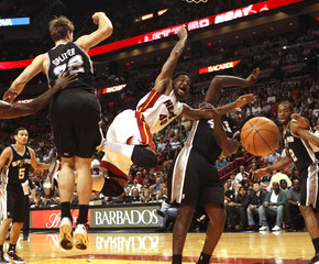 Miami Heat power forward Haslem is fouled by San Antonio Spurs forward Blair as Splitter defends during their NBA basketball game in Miami