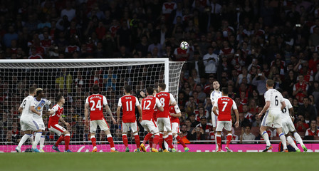 Sunderland's Sebastian Larsson (not pictured) takes an indirect free kick from inside the area before Arsenal's Granit Xhaka heads over his own crossbar