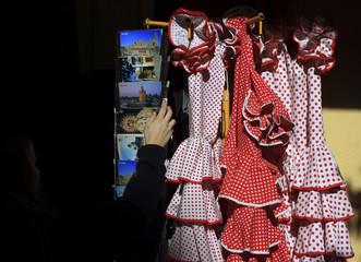 A tourist takes a postcard in Seville