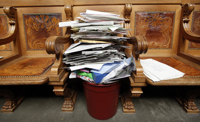 A recycling bin filled with paper is seen in the National Council after the last day of the summer parliament session in Bern