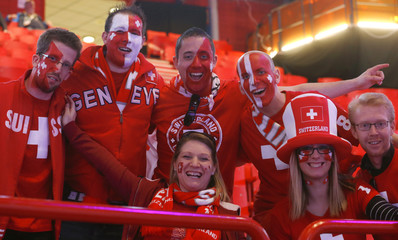 Fans from Switzerland await their team's preliminary round match against Slovenia at the 2013 IIHF Ice Hockey World Championship at the Globe Arena in Stockholm