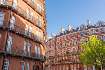 Opulent restored elegant Victorian period building in red bricks and white windows in South Kensington, London, UK