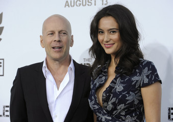 """Bruce Willis and Emma Heming attend the premiere of the film """"The Expendables"""" in Los Angeles"""