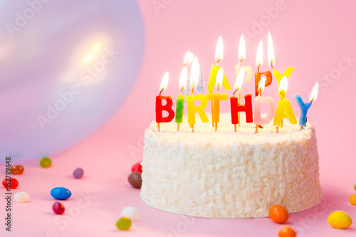 Birthday Cake Balloons Images ~ Close up of delicious birthday cake with candles hats and