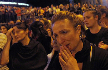 A woman reacts during a demonstration against the government in Tbilisi