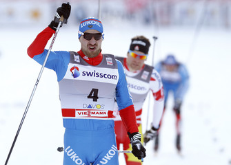 Petukhov of Russia reacts after crossing the finish line to win the men's cross country individual 1500m sprint free finals at the FIS World Cup in Davos