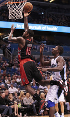Toronto Raptors' Johnson shoots around Orlando Magic's Nicholson during their NBA basketball game in Orlando