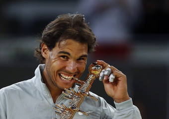 Nadal of Spain poses with the Ion Tiriac trophy after his victory over Nishikori of Japan in their men's singles final match at the Madrid Open tennis tournament